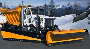Truck with snow plow and spreader